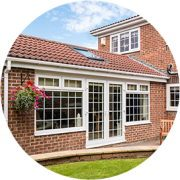 Modern Sunroom or conservatory extending into the garden surrounded by a block paved patio